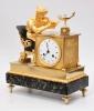 A French Empire 'La Lectura' ormolu and bronze mantel clock, circa 1800