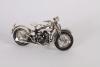 A silvered model of a Harley Davidson, modern