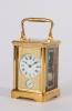 A French gilt brass quarter repeating alarm carriage timepiece circa 1880
