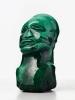 An malachite sculpture of an African man, circa 1970