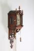 An attractive Dutch Frisian maddered oak striking alarm 'staartschippertje'wall clock, circa 1830.