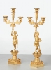 A pair of French bronze 'Paul and Virginie' candlesticks, circa 1830