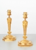 A fine pair of French Regency inspired gilt bronze candlesticks, circa 1880