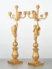 A pair of French bronze five-arm candlesticks with angels, circa 1830