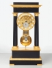 A fine French ebonised and gilded bronze four pillar mantel clock by Cleret, circa 1825