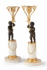 A pair of candlesticks with putti on white column