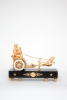 A French empire ormolu and marble chariot mantel clock, circa 1800