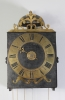 An early French provincial iron and brass Morbier wall clock, circa 1735