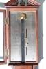An English mahogany and ebony stick barometer, by Gilbert Gilkerson, circa 1820