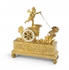 Empire Gilt Bronze Mantel clock with a winged putto in a chariot