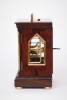 A small English brass bound rosewood library timepiece by Mc Cabe London, circa 1840