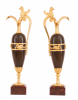 A pair of empire patinated bronze and fire gilded ewers, Circa 1810