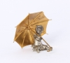 'Seated girl with umbrella', silvered and gilt bronze sculpture, circa 1880.