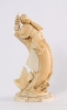 'Man on a Carp', a Japanese carved ivory sculpture, circa 1880
