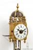 A rare miniature French brass striking and alarm lantern clock, circa 1750