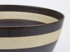 Lucie Rie, turned footed bowl, with stamped mark LR at the bottom.