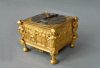 A square horizontal gilt brass table clock, signed Albrecht à Berlin, circa 1700.