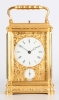 A fine French engraved gilt brass gorge case travel clock with alarm by Drocourt, circa 1880.