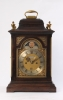 A small English ebonised table clock with moonphase, by Robert Wood, circa 1770