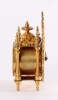A miniature French Regence-style gilt brass table timepiece, circa 1870.