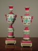 A pair of polychrome porcelain urns 'à double usage', mid 19th Century.