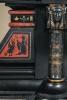 A fantastic black marble 'retour de l'Egypt' mantle clock with two side pieces.