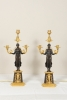 A large pair of ormolu and bronze Nikè Empire candelabra.