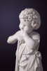 Marble sculpture of a boy with hammer