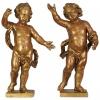 A pair of Dutch giltwood pendant figures of putti, circa 1660