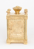 An English engraved gilt brass travel clock, Aubert & Klaftenberger, circa 1860.