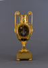 A French ormolu Empire vase mantel clock