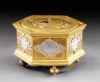 T14 Gilt brass and silver mounted hexagonal table clock with moon phase and alarm.