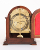 A small English rosewood table clock by Frodsham London, circa 1850.