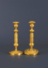 A pair of French Directoire candlesticks, around 1890