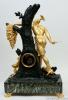 An important French gilt bronze sculptural mantel clock, Jason and the Golden Fleece, circa 1820.