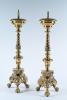 A pair of brass, 17th century candlesticks