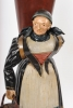 A pendant pair of German Black Forest polychrome metal figures, circa 1840