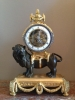 M175 Louis XVI mantel lion clock, with skeletonized clockwork, silver hands and frame on the bezel and striking on a silver bell