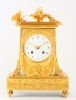 A lovely French Empire ormolu borne mantel clock with butterfly, circa 1800