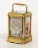 A French porcelain mounted gilt brass carriage alarm clock,circa 1880