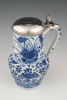 A Chinese porcelain jug with silver lid