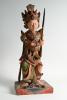 A  polychrome Balinese wooden sculpture.