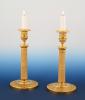 A pair of ormolu bronze Empire candle sticks