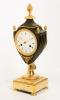 A fine French Empire ormolu and bronze urn mantel clock by Armingaud L.né à Paris, circa 1800
