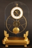 S06 A glass mounted skeleton clock