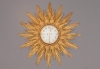 An impressive Dutch giltwood sunburst quarter striking wall clock, circa 1770