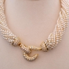 Interchangeable precious stone/pearl necklace.
