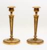 A pair French Empire fire-gilt candlesticks, circa 1800
