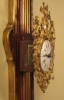 W30 Rack clock mounted on a shaped giltwood backboard.
