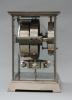 M122 Vernikkelde Art Deco stijl J.L. Reutter 4 zijdig verglaasde Atmos klok, in kleine uitvoering.